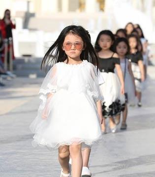 高端亲子童装T100走出国门 为全球最大主题乐园打造百童大秀