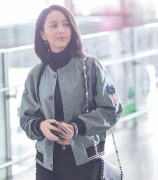 """""""时尚辣妈""""佟丽娅现身机场 性感露脐装秀出结实小腹"""